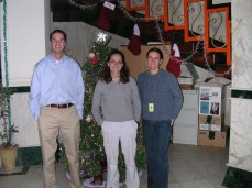 New Years Day, 2005, Tikirt, Iraq. With Suzanne, State Department, and Gail, USAID. Two of my best friends. Behind the tree is a $10,000 copy machine that worked for about a week before the dust jammed it. It was impossible to fix without a technician and Ricoh wouldn't send one to Iraq, I called.
